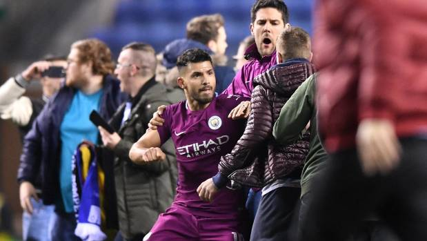 3rd-tier Wigan shoots down City