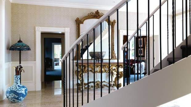 The French console in the front entrance dates back to around 1710; the plaster and wire mirror was a Trade Me find that ...