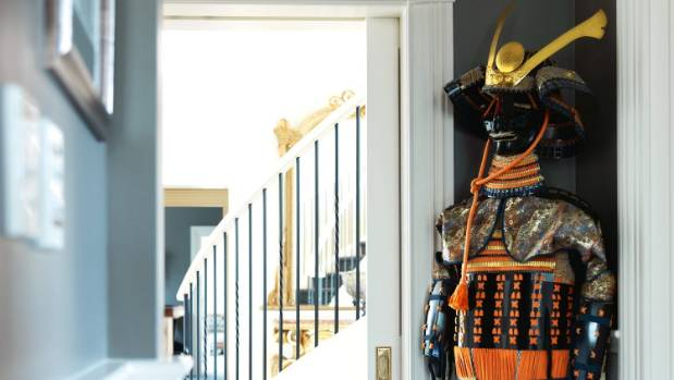 Carl's keen interest in martial arts is reflected in the Japanese samurai suit of armour standing in the hallway.