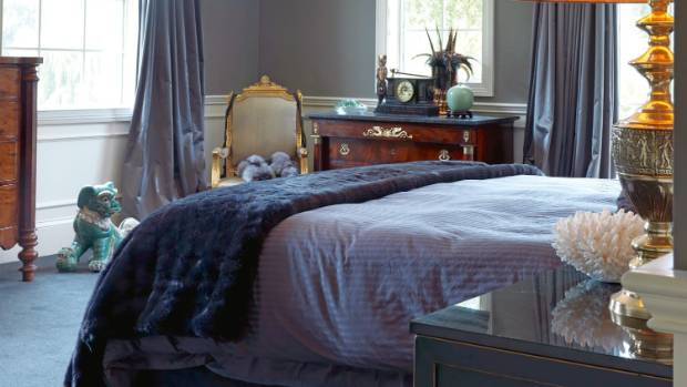 The master bedroom leads to a large balcony overlooking the gardens.