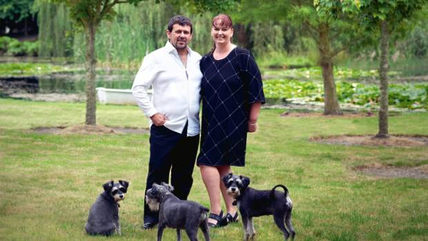 Tara-Jayne Stapleton and Carl Loader beneath some of the oak trees that survived the couple's deciduous culling; when ...