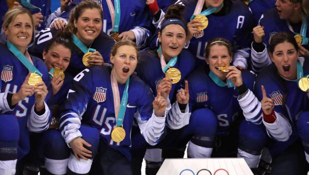 2018 winter olympics usa beat canada in shootout to end womens ice usa players celebrate on the ice with their gold medals after defeating canada in a shootout freerunsca Image collections