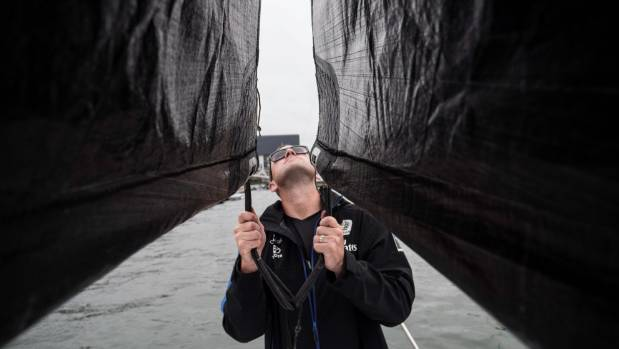 Team New Zealand's Tim Meldrum between the two sails that make up the revolutionary wing sail.