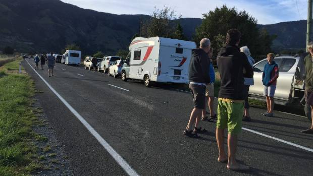 A queue of campervans and cars on State Highway 60, waiting to cross the Takaka Hill. Golden Bay has been cut-off from ...