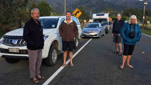 Neil Bermingham, left, with Linda and Steve Ellison wait to get out of Golden Bay.