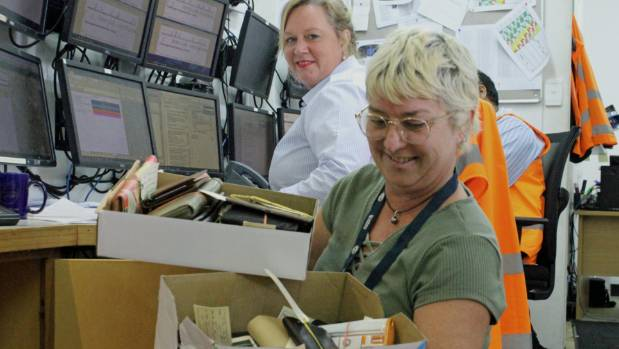 NZ Bus duty supervisor Jo Anderson, foreground, and her team at the control desk log lost items and try and reunite ...