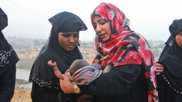 Noble Peace laureate from Yemen, Tawakkol Karman, right, holds a Rohingya refugee child during her visit to Kutupalong ...