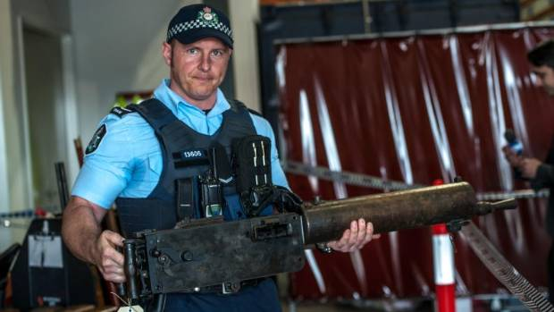 First constable Douglas Djurica with a WWI machine gun that was handed is as part of Australia's National Firearms Amnesty.