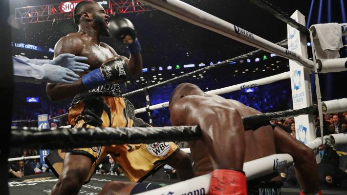 54a72e95b2b3 Deontay Wilder blasts Luis Ortiz through the ropes during their WBC  heavyweight title fight in New