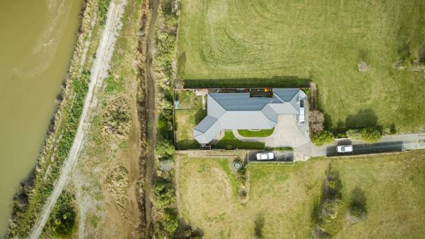 Martin and Rae Francis' Bexley home is one of only two left in the desolate red-zoned part of the suburb.