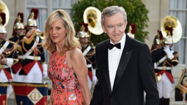 Head of LVMH Bernard Arnault, pictured here with his wife Helene Arnault, is an investor in Viagogo.