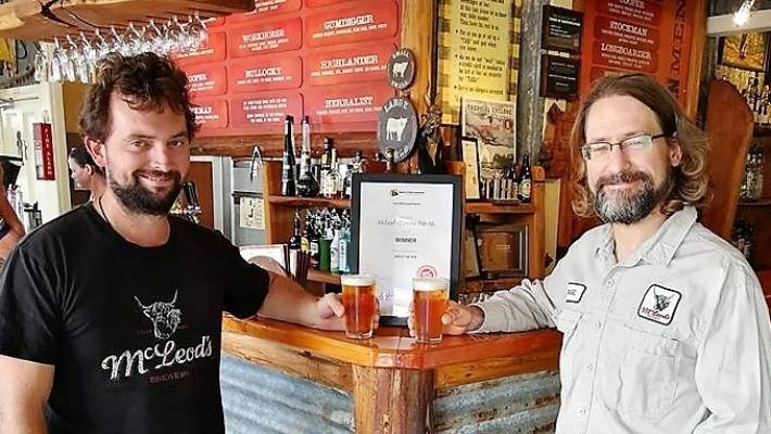 McLeod's head brewer Jason Bathgate, right, and assistant Milton Mewett celebrate their Paradise Pale Ale being named New Zealand's best beer by members of Soba.