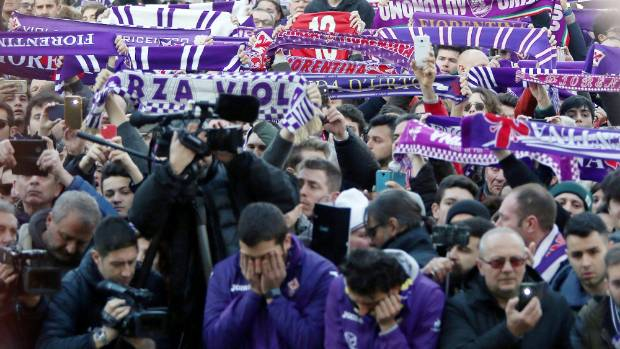 Fiorentina fans gather ahead of a funeral service for captain Davide Astori