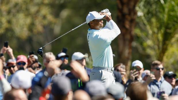 tiger woods tops pga tour leaderboard for the first time