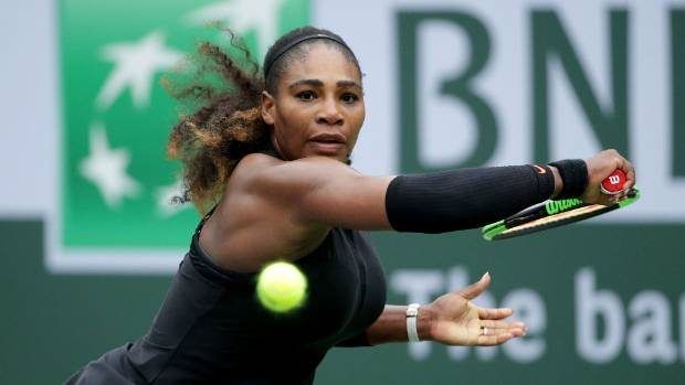 Serena Williams lunges to return a backhand to Kiki Bertens of the Netherlands during her second round victory