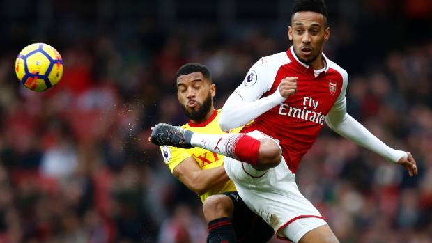 Pierre-Emerick Aubameyang of Arsenal and Adrian Mariappa of Watford in action during their Premier League match