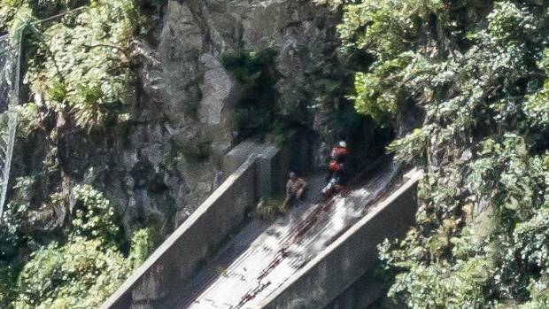 The man remained on the flume for about 18 hours until crews abseiled to him from above.