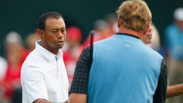 Tiger Woods and Ernie Els shake hands after a match at the 2013 Presidents Cup