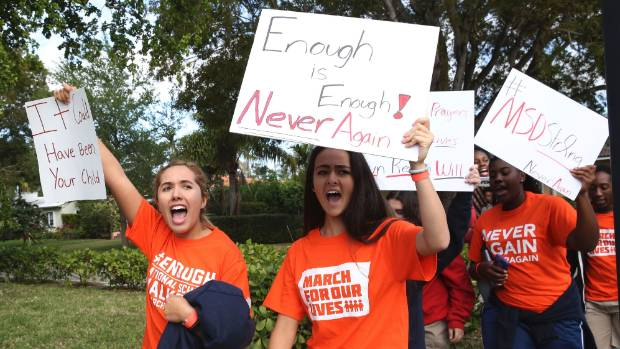 Students from Miami County Day School walk out of their school to protest gun violence in Miami Shores Florida