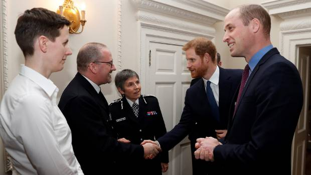 Prince William right and Prince Harry chat with Metropolitan Police Commissioner Cressida Dick centre police officer