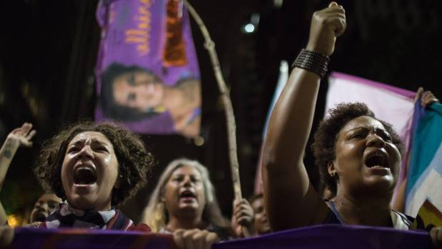 Protesters shout slogans after the murder of councilwoman Marielle Franco in Rio de Janeiro Brazil