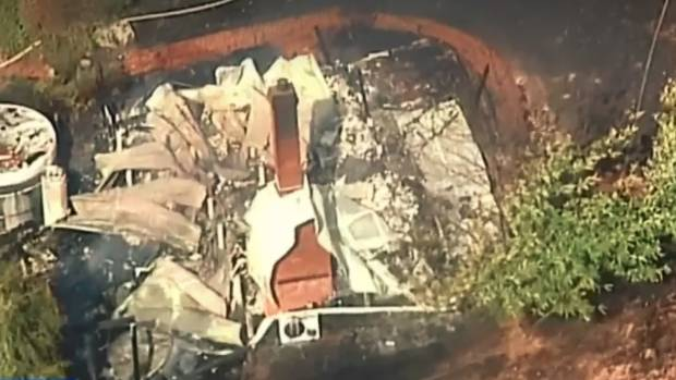 Raging Australia Bushfire Destroys 70 Homes and Sends Residents Fleeing