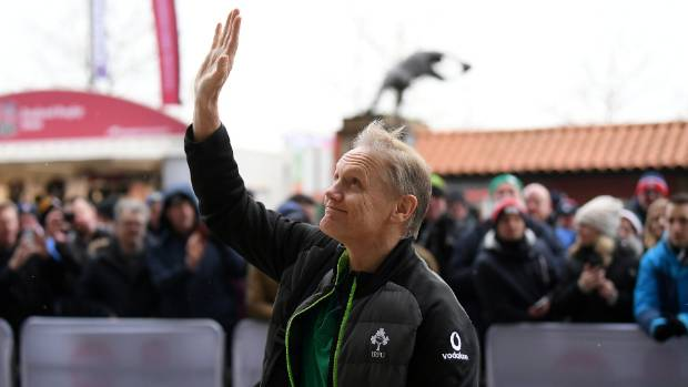 Joe Schmidt acknowleges Irish rugby fans on arrival at Twickenham for the Grand Slam clinching test against England