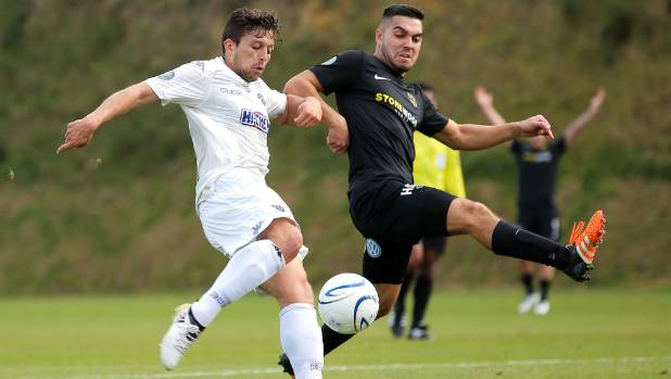 Justin Gulley of Team Wellington, right, marks up against Auckland City's Darren White during an encounter last year.