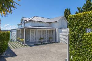 From the street, this $14.5m house at 13 Marine Parade, Herne Bay gives little away.