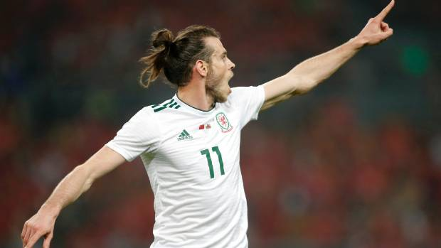 Bale nets hat-trick as Wales smash China