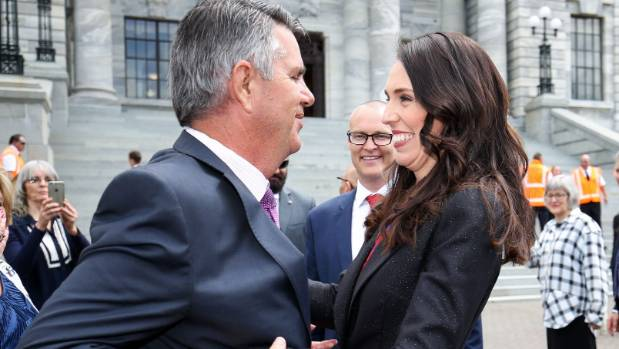 Pregnant Prime Minister Jacinda Ardern gets a helping hand from dad