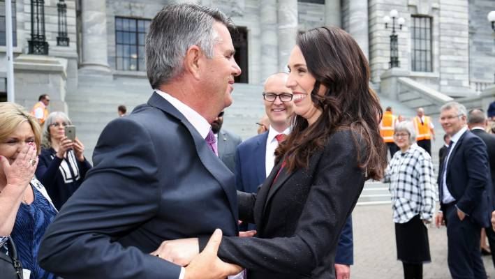Prime Minister Jacinda Ardern hugs her father Ross Ardern at Parliament following a swearing-in ceremony at Government House in October 2017.