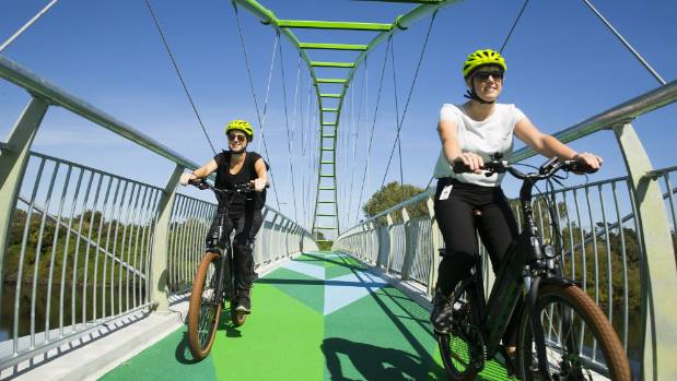 Mychelle Tomsett, left, and Deborah Scott take Electrify.NZ bikes for a spin.