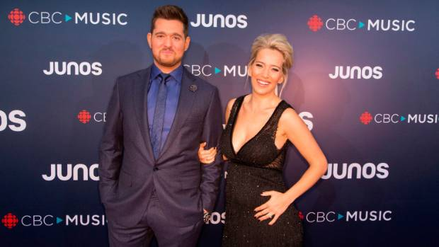Michael Buble and his wife Luisana Lopilato during her pregnancy