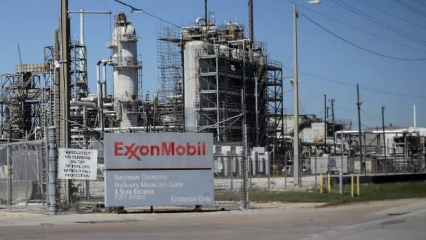 Exxon promises to cut emissions that hasten climate change