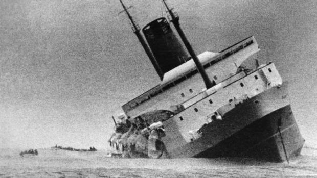 The Wahine heavily listing shortly before sinking in Wellington Harbour on April 10, 1968. Lifeboats are just visible on ...