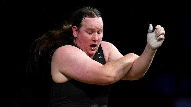 Laurel Hubbard of New Zealand reacts after dropping the bar and injuring her arm causing her to withdraw from the