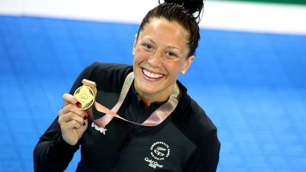 Sophie Pascoe proudly shows off her gold medal after winning the women's SB9 100m breaststroke final.