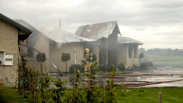 Firefighters Dampen Down Hot Spots