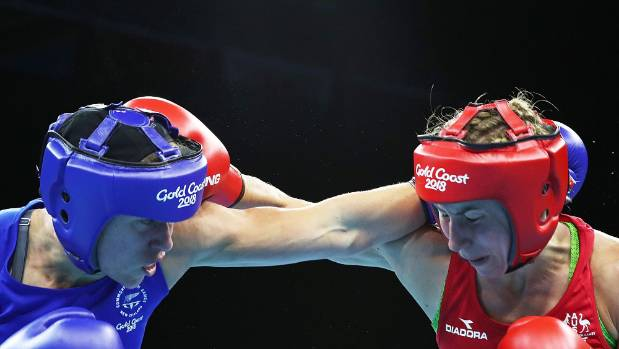 NZ's Troy Garton left and Anja Stridsman of Australia exchange blows