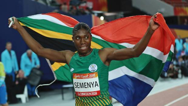 South Africa's Caster Semenya celebrates winning gold in the woman's 800m final at Carrara Stadium during the