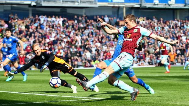 Chris Wood nets the opening goal of the game in Burnley's 2-1 EPL win over Leicester