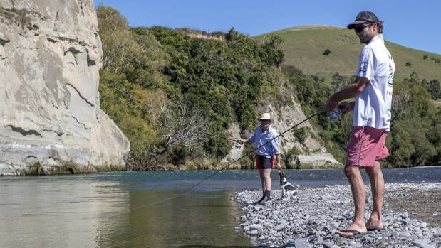 The Hurunui in North Canterbury attracts thousands of people, many of whom, like Pete Dormer, left, and Guy Higginson, ...