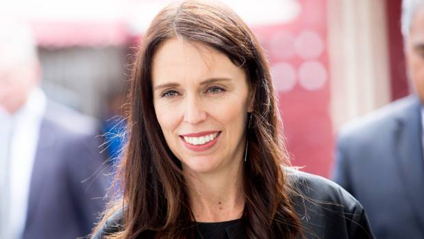 New Zealand PM visits France to talk free-trade (and sore feet)