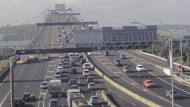 Two lanes are blocked on the Auckland Harbour Bridge as emergency services attend to a car fire.