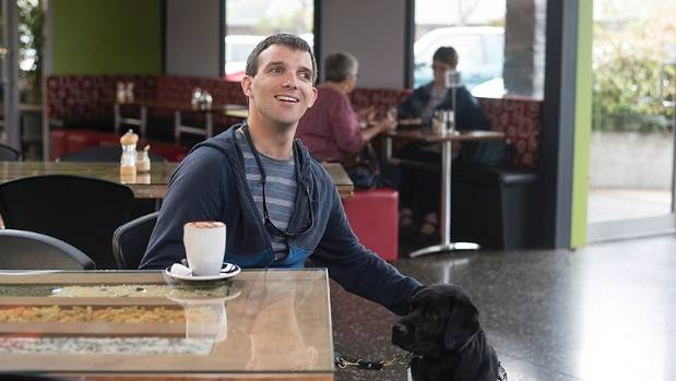 Morgan, with his guide dog, Jessie J, enjoys a coffee at the Secret Garden cafe in Spreydon, Christchurch.