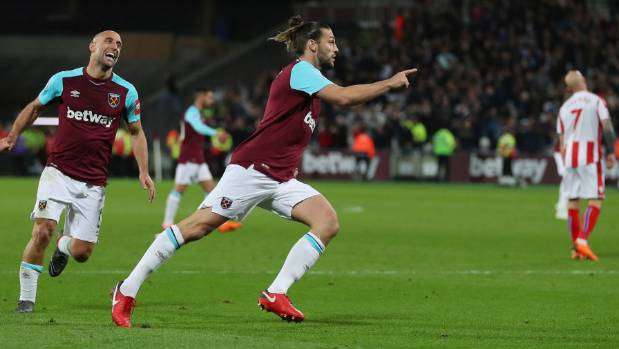 Carroll answers Hammers' SOS call to crank up heat on Stoke