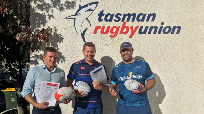 Tasman Rugby Union board member Scott Gibbons, rugby development officer Mark Cochrane and community rugby manager Kahu Marfell with some of the coaching resources designed to upskill local mentors.