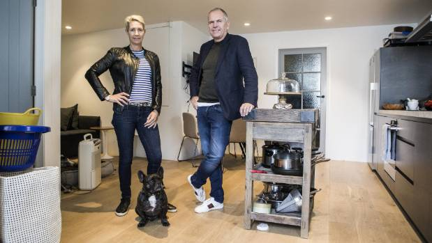 Paul Izzard, partner Nicole Pangari and their French bulldog, Edward, in their 60 square metre apartment.