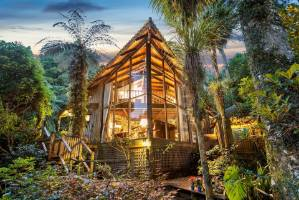 A chalet in the jungle - this Waiatarua house for sale is at one with the native bush landscape. The house has come onto ...